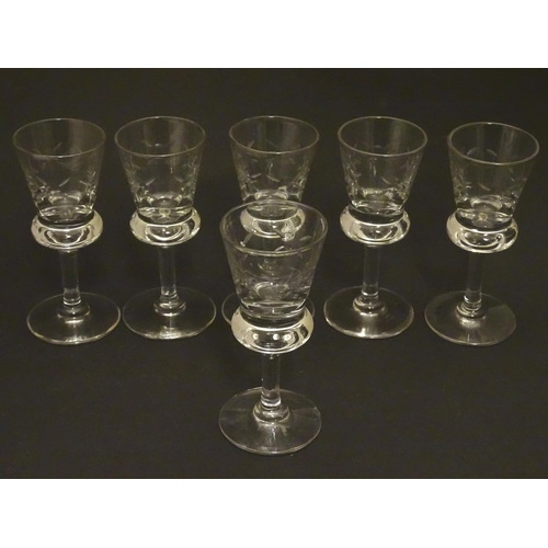 218 - A set of six crystal sherry glasses formed as thistles, with cut roundel  decoration, each 4 1/8