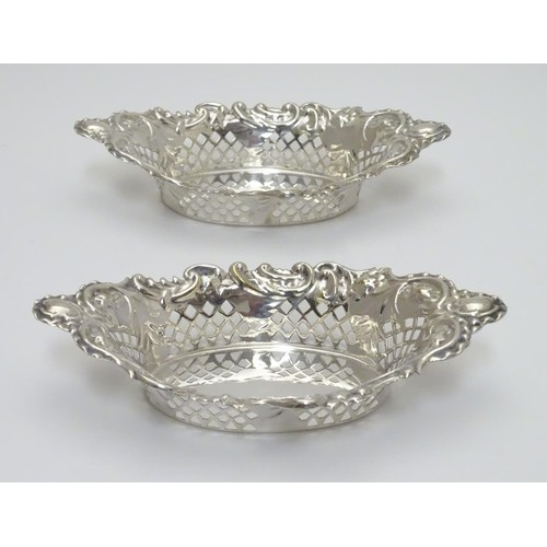 239 - A pair of silver plate bon bon dishes with pierced decoration. Approx. 6