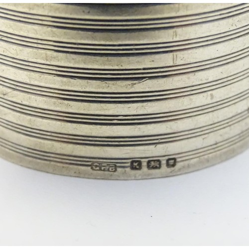 244 - An Art Deco silver napkin ring with banded decoration. Hallmarked London 1945 maker GFB