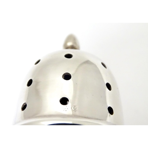 364 - An art Deco silver sugar caster, with Bakelite lining and engine turned decoration. Hallmarked Birmi...