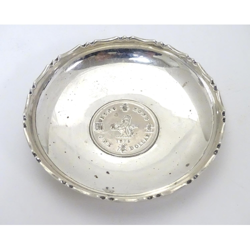 452 - A Chinese Export silver pin dish of circular form with inset  QEII Hong Kong Dollar to centre.  3 1/...