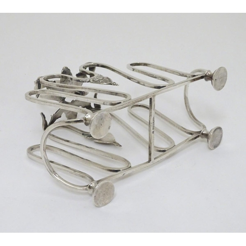 475 - A silver plate toast / letter rack with scroll and shell decoration 7