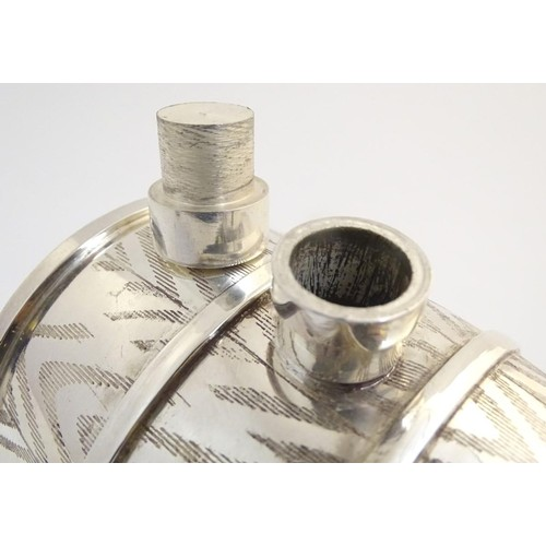 488 - A 21stC novelty silver plated spirit flask, the base formed as a bear laying on a sled supporting a ...