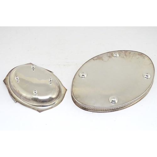500 - A silver plated oval tray with galleried side together with a cake basket with swing over handle. Th...
