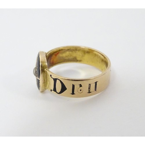 521 - Mourning / memorial jewellery: A 19thC gold ring with black enamel and diamond decoration. Ring size...