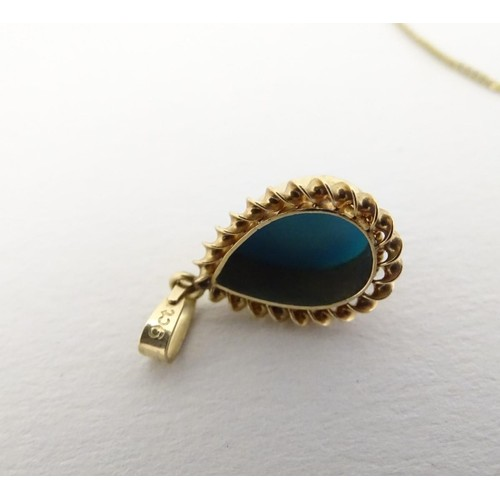 558 - A 9ct gold pendant and chain, the pendant set with turquoise cabochon, together with a 9ct gold chai...