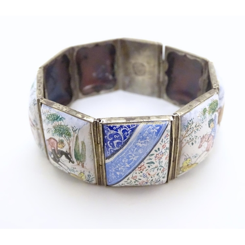 565 - A late 19thC / early 20thC indo-persian bracelet set with decorative enamel links depicting figures,...