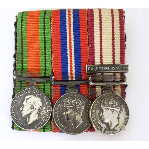 666 - Militaria: a miniature campaign medal group, comprising WWII/WW2/Second World War Defence and War me...