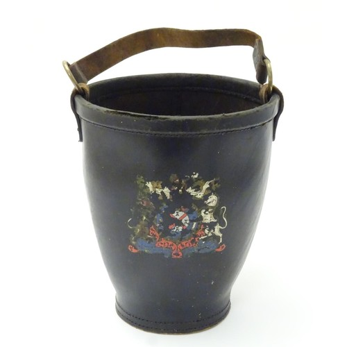 670 - A leather fire bucket with traces of polychrome decoration of the Royal coat of arms. Impressed Made...