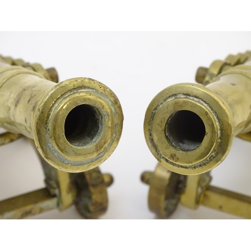 678 - Militaria: a pair of early 20thC cast brass model desk cannons, each 8 1/4