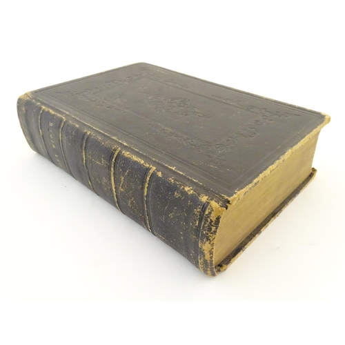 693 - Book: The Holy Bible, King James version, pub. Oxford University Press, 1852. The leather cover with...