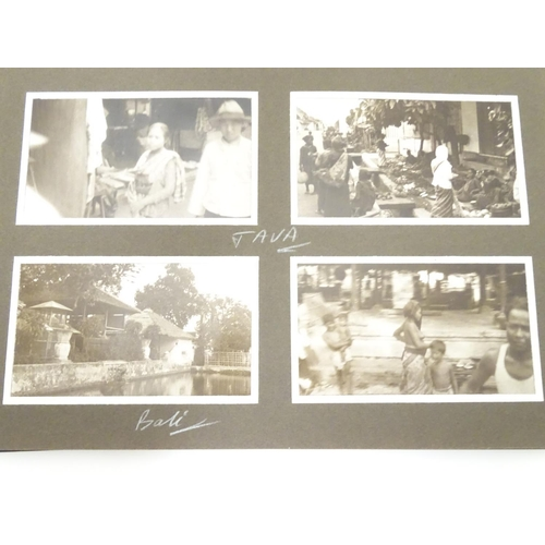 805 - A c1920 photograph album, containing 85 monochrome photographs of Indian and Indonesian locations in...