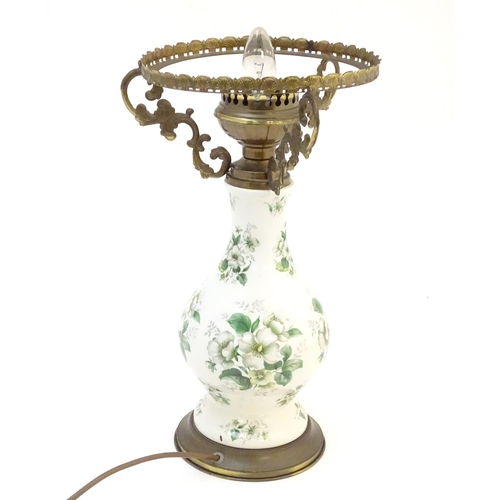 906 - A 20thC table lamp, the ceramic baluster shaped body with floral detail . The whole approx 17