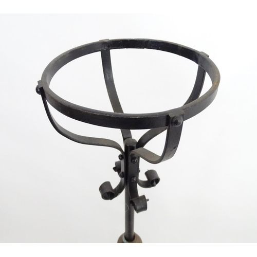 913 - A Victorian wrought iron and copper telescopic standard lamp with burner marked ' Lampe veritas ' Ap...