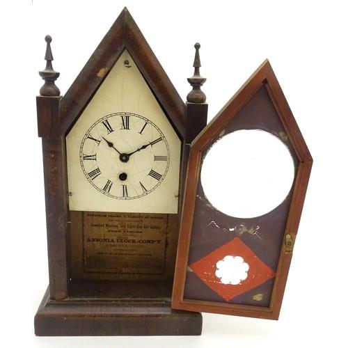 933 - Lancet Mantel Clock: An Ansonia Clock Company walnut cased 30hr clock, with 4 1/4