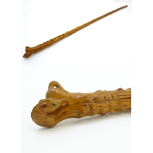 941 - A 20thC hawthorn cane / stick with carved horse finial and lacquered finish. Approx. 40