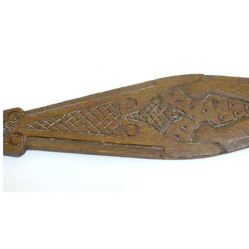 948 - Ethnographic / Native / Tribal: A carved wooden ceremonial paddle formed as a stylised fish with car...