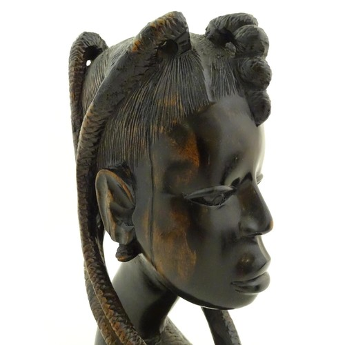 957 - Ethnographic / Native / Tribal: Three African hardwood carvings, to include a bust of a woman, a car...