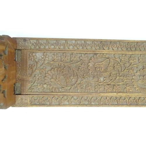 993 - A large South Asian carved wooden extending book slide with hinged ends with floral and foliate deco...
