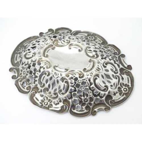 234 - A Victorian silver bon bon dish with embossed decoration. Hallmarked Birmingham 1899, Benjamin Thoma...