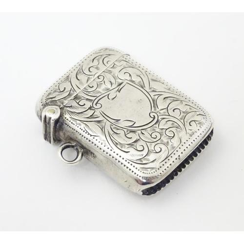 247 - A silver vesta case with engraved decoration. Hallmarked Birmingham 1913 maker Joseph Gloster Ltd.  ...