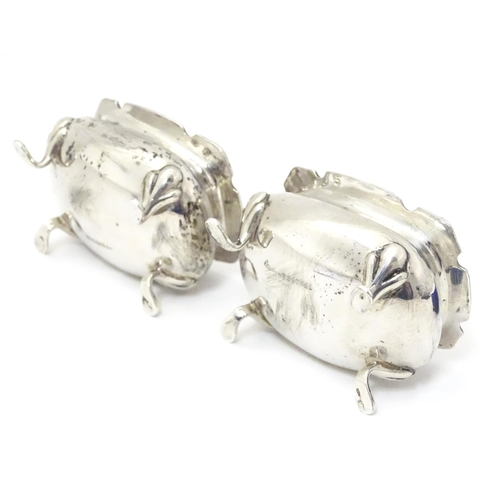 250 - A pair of silver salts with blue glass liners, hallmarked Sheffield 1908 maker Walker & Hall.  2 1/2...
