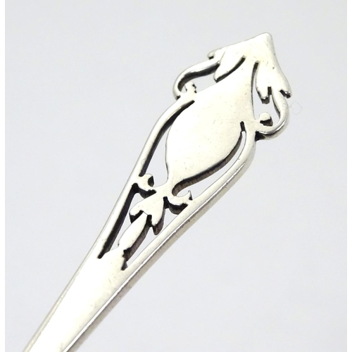 260 - A silver jam / preserve spoon with fretwork decoration to handle, hallmarked Sheffield 1933 maker Ha...