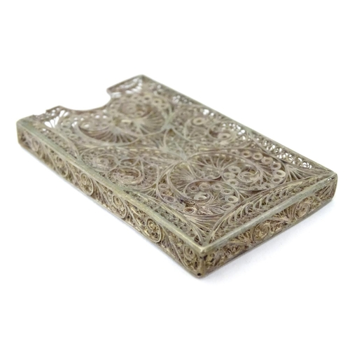 263 - A white metal card vase with filigree decoration .  3