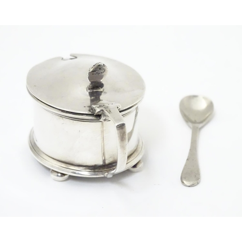 266 - A silver mustard pot hallmarked Birmingham 1935 maker H J Cooper & Co Ltd, with blue glass liner and...