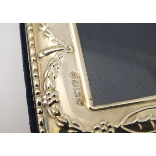 279 - A silver mounted photograph frame with ribbon and swag decoration, hallmarked Sheffield 1994, maker ...