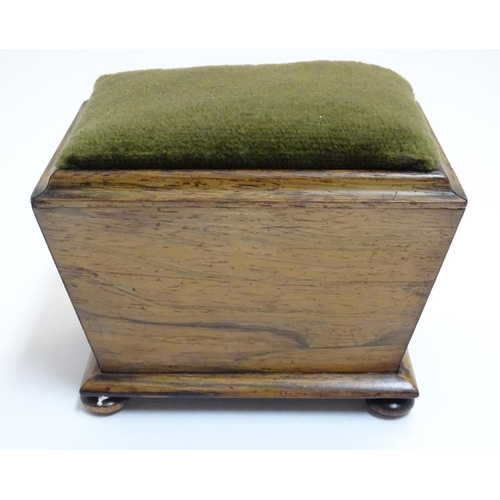 1092 - A 19thC rosewood sewing pin cushion of sarcophagus form with four bun feet. Approx. 4 1/4