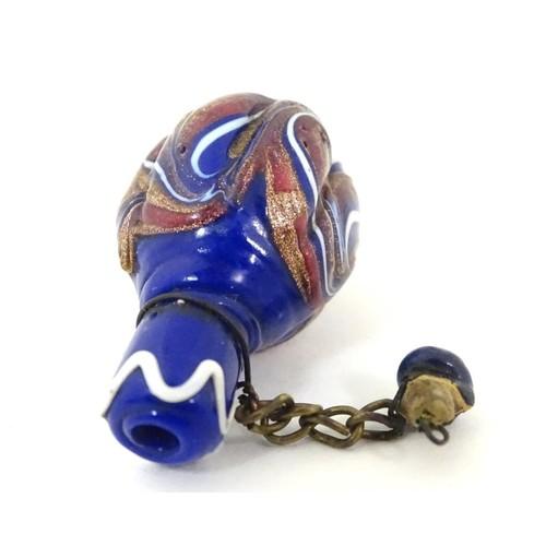 1110 - A miniature scent bottle with enamel decoration. 1 1/2