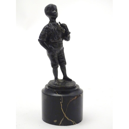 1135 - A 20thC cast figure of a negro boy smoking a pipe. Signed R. Moret. On a marble base. Approx. 5 1/2