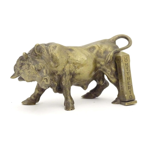 1158 - An early 20thC brass model of a charging bull, with a post engraved From Harry Granger, Hitherto, 19...