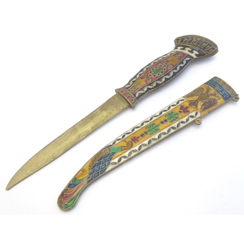 1198 - A paper knife modelled as dagger with scabbard cloisonne decoration depicting a double headed eagle ...