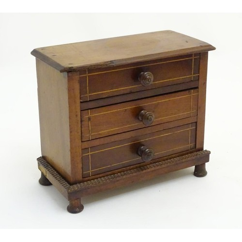 1199 - An early 20thC mahogany apprentice piece / miniature chest of drawers, with 3 drawers. Approx. 6 1/2...