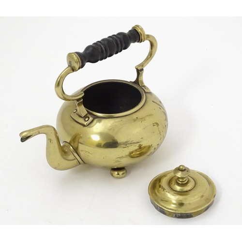 1217 - A late 19thC brass kettle of squat form with squat bun feet. Approx 7 1/2