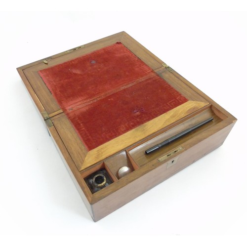 1288 - A 19thC walnut writing slope with inkwell. Approx. 14