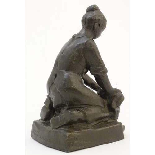 1313 - An early 20thC Continental cast model of a washerwoman after Jan H. Schoenmakers, stamped VVV Beek-U...