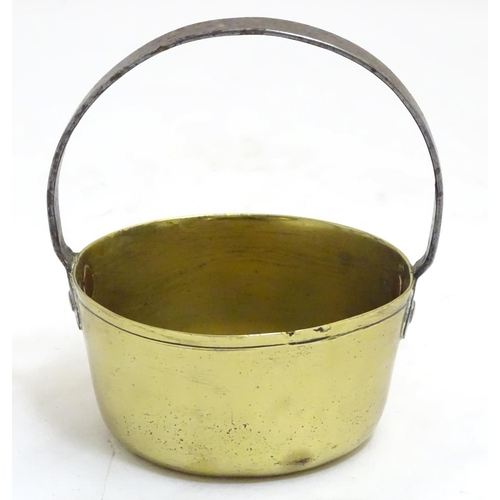 1331 - A 19thC small brass caramel pan, with fixed cast iron handle, 5 5/8