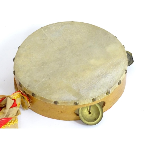 1315A - Musical Instrument: a mid 20thC Zim Gar conga drum, 21 tall , together with a small tambourine