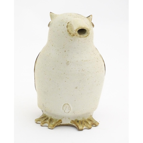 103 - A studio pottery model of a bird with an elongated beak. Impressed marks above feet. Approx. 6 1/4
