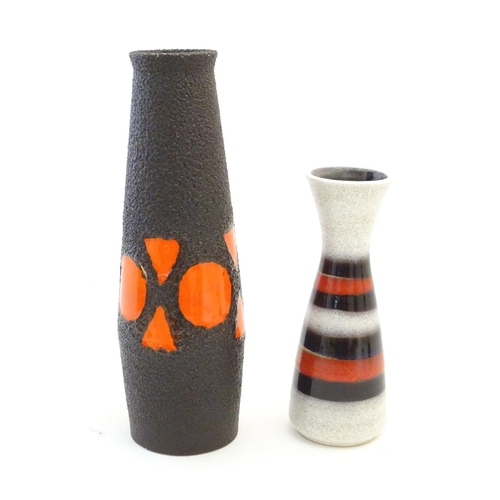 109 - Two West German vases comprising a tall slender example, and a slim vase with a flared rim and bande...
