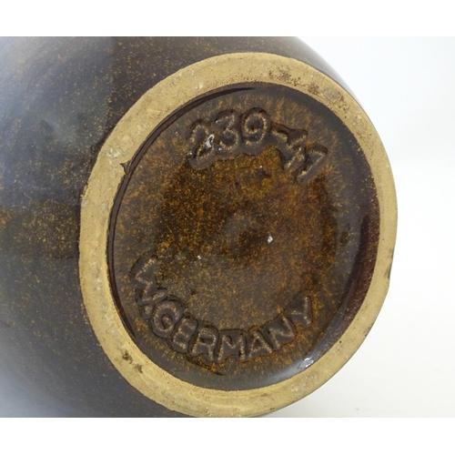 117A - A West German vase by Scheurich. Marked under. Approx. 16 1/4