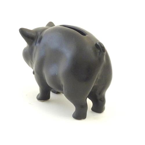 146 - A Sylvac matte black money / piggy bank modelled as a pot bellied pig, no. 1132. Approx. 3
