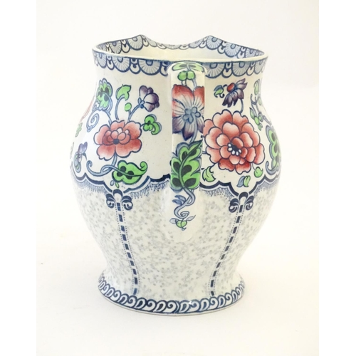 147 - A Maling jug of baluster form with floral and foliate detail. Marked under. Approx. 7 1/4