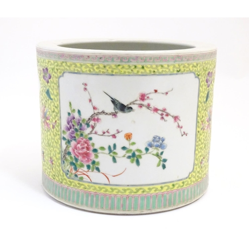 2 - A Chinese famille jaune planter with a floral and foliate ground and panelled decoration with birds ...