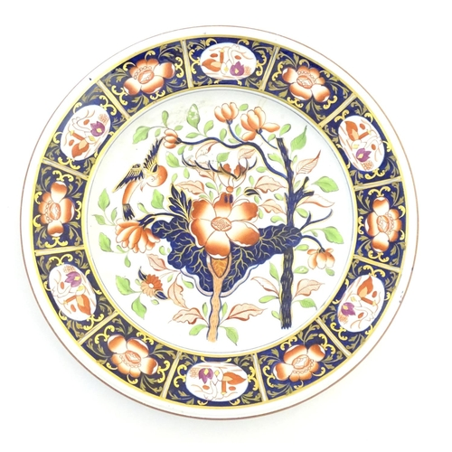 79 - A Copeland hand painted plate in the Imari palette with floral, foliate and bird detail with gilt hi...