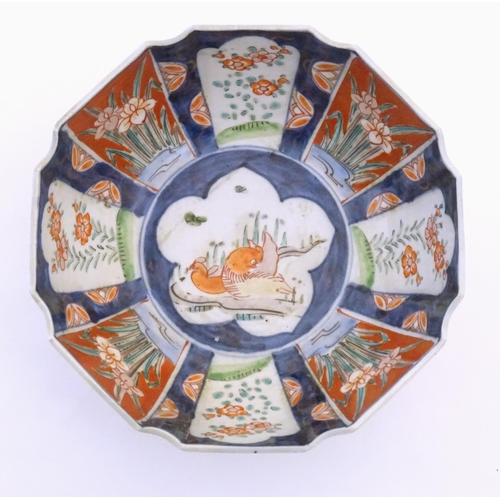37 - A Japanese octagonal bowl in the Imari palette the centre decorated with ducks in a pond, the sides ...