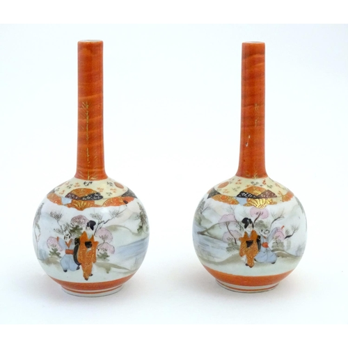 41 - Two Japanese Kutani bottle vases decorated figures in a landscape scenes. Character marks under. App...